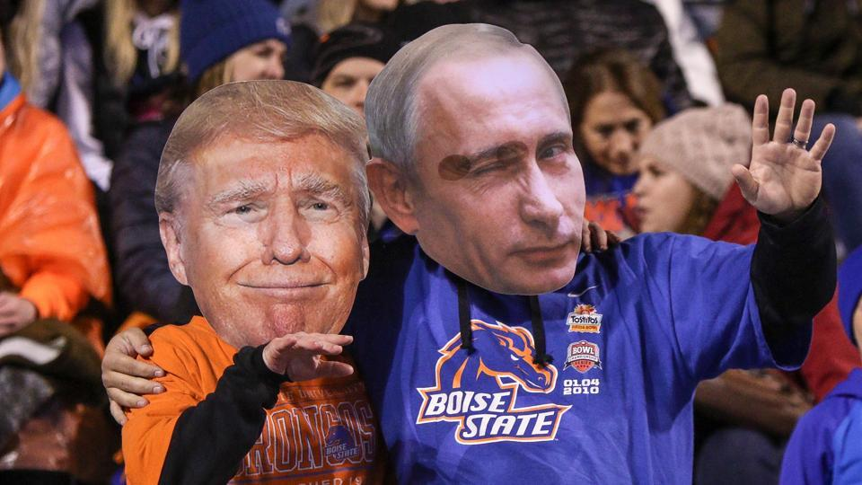 A couple of Boise State Broncos fans wear Donald Trump and Vladimir Putin  during a match at Albertsons Stadium in Boise, Idaho.