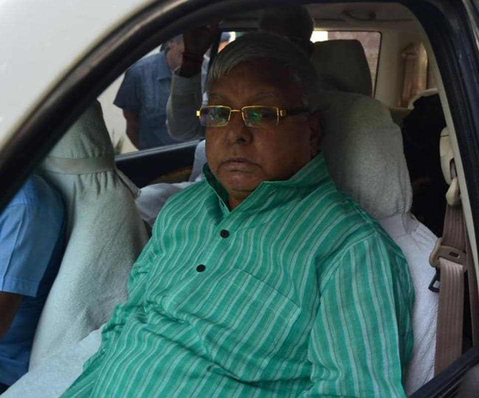 RJD chief Lalu Prasad answering reporters' questions in Patna on Sunday.