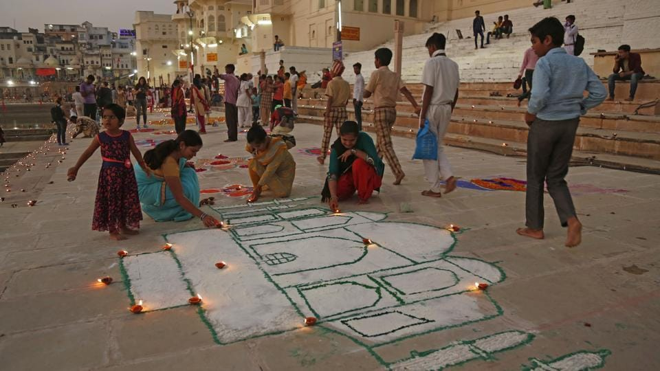 Students of Pragya Bal Niketan made a replica of the Taj Mahal with colours and lit lamps during Deepdan ceremony in Pushkar on Sunday.