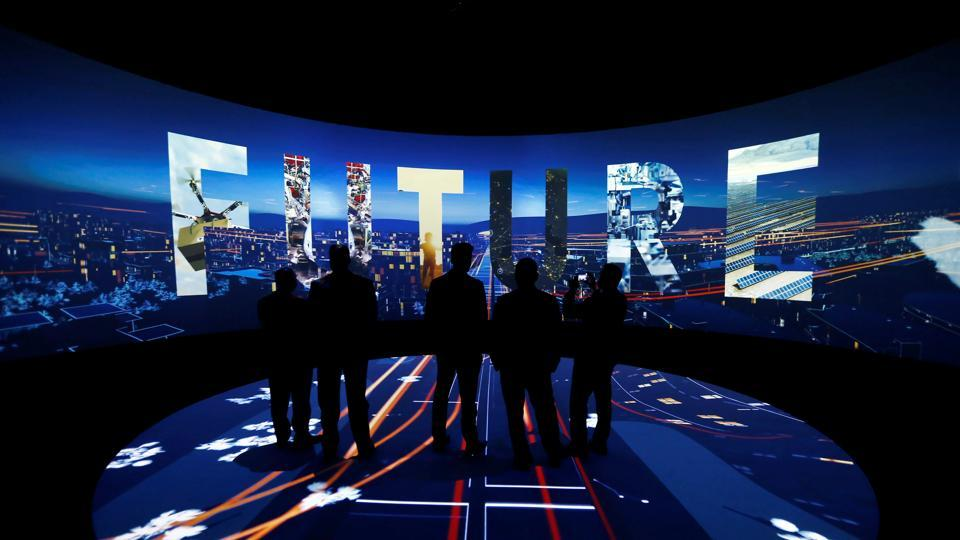 FILE PHOTO: Visitors watch a 3D presentation during an exhibition on