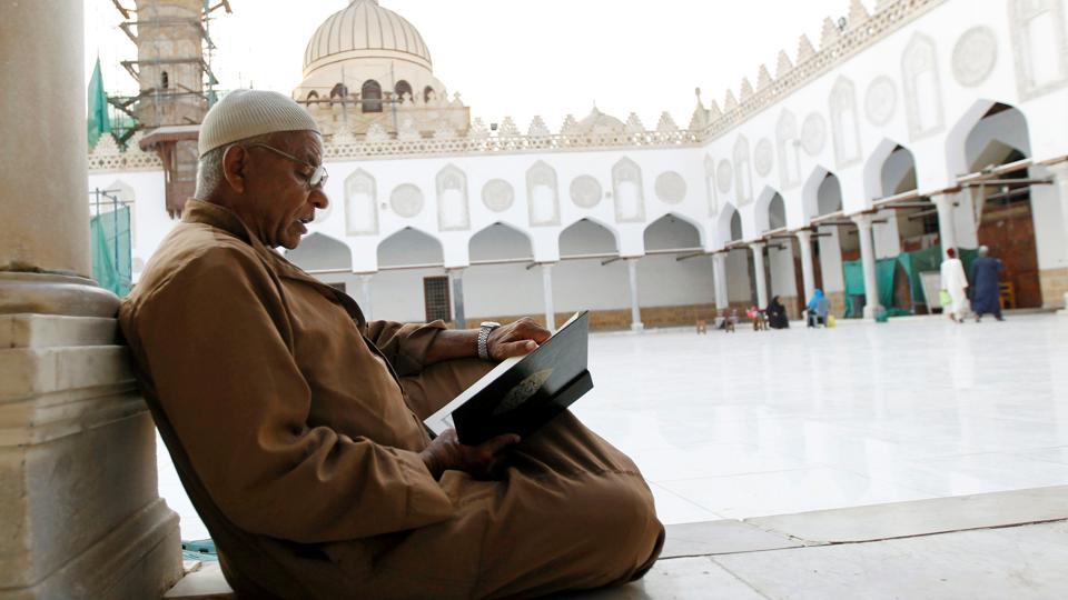 A Muslim man reads the Koran, at Al Azhar mosque in old Cairo, Egypt.