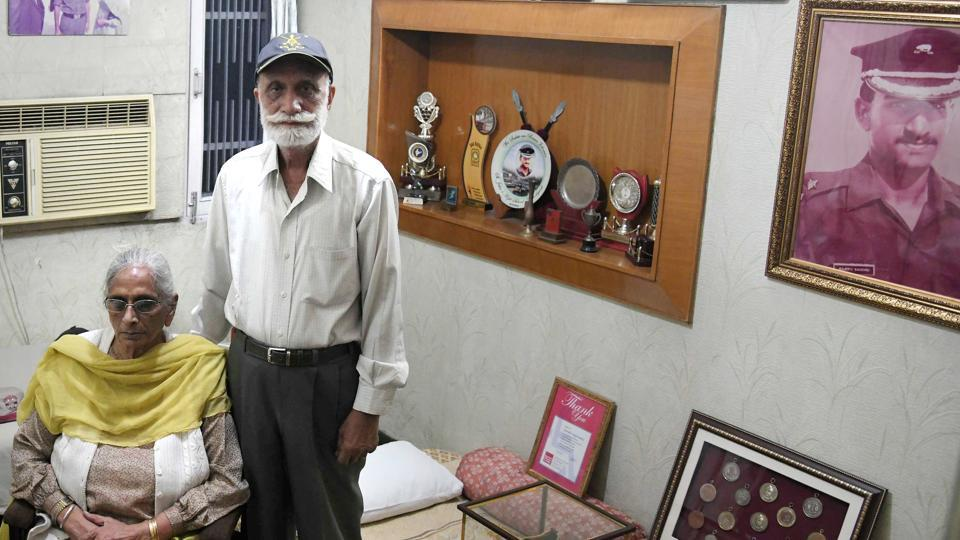 Second Lieutenant Rajeev Sandhu's father DS Sandhu and mother JK Sandhu at their house in Sector 45, Chandigarh, on Saturday. They have dedicated a small room to him and put all of his belongings right from his childhood till his commissioning as an officer in March 1988.