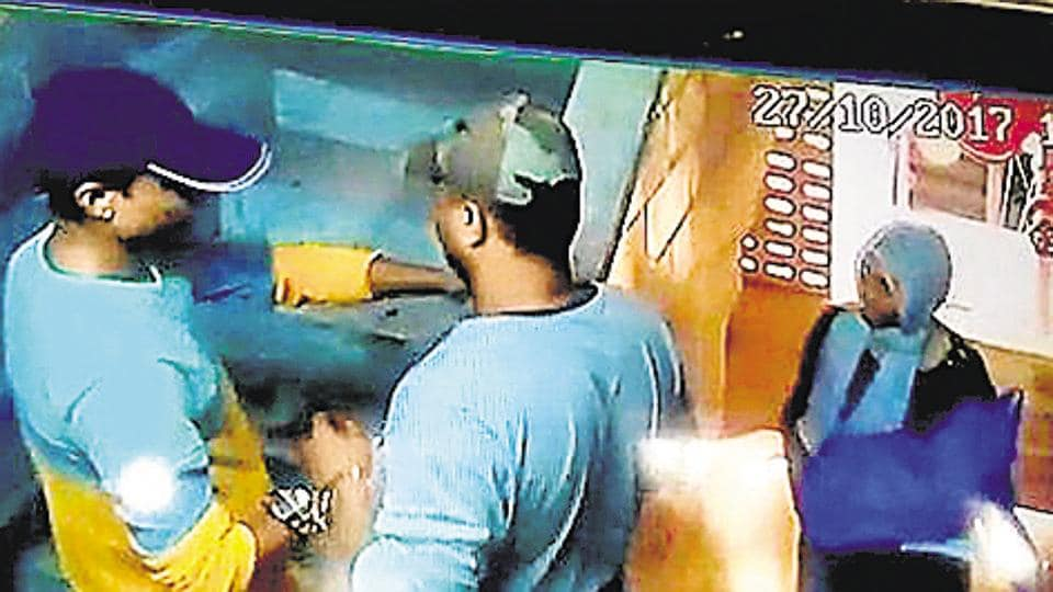 A CCTV grab shows three of the six robbers.