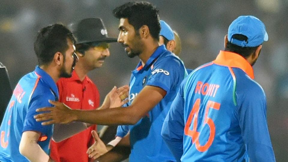 Jasprit Bumrah and Yuzvendra Chahal  (L) celebrate after India's victory over New Zealand in the 3rd ODI in Kanpur.