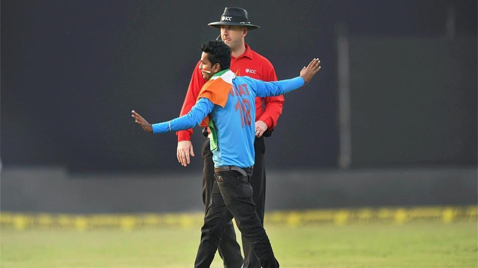 A Virat Kohli fan enters the field during the 3rd ODI between India and New Zealand at Green Park in Kanpur on Sunday.