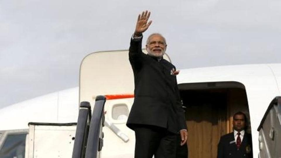 Prime Minister Narendra Modi waves as he boards a plane after his trip to Afghanistan in 2015.