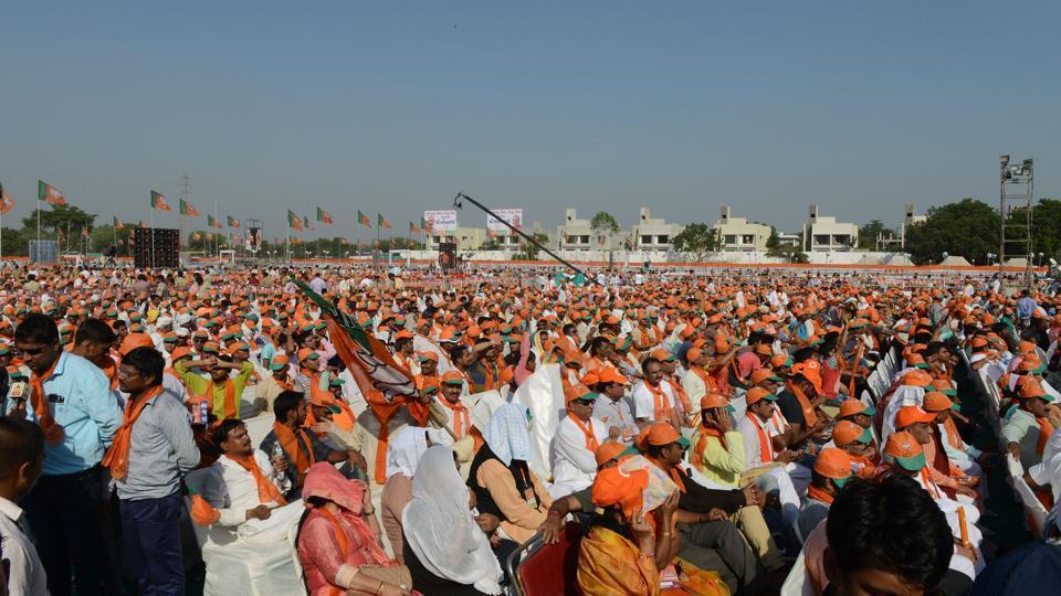 Supporters assemble at a gathering of Bhartiya Janata Party during Gujarat Gaurav Mahasamellan at Bhaat village on the outskirts of Ahmedabad on October 16.