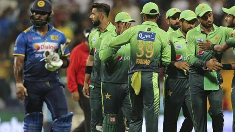 Pakistan celebrate the dismissal of a Sri Lankan batsman in the third T20I of a three-match series in Lahore on Sunday. Get full cricket score of third Pakistan vs Sri Lanka T20I in Lahore here.