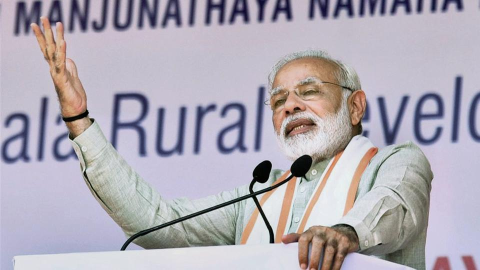 Prime Minister Narendra Modi addresses a public meeting for the launch of various programme at Ujire, in Karnataka on Sunday.