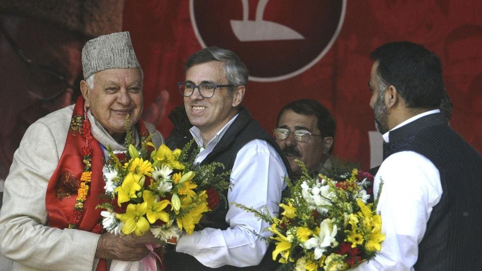National Conference working president Omar Abdullah greets his father Farooq Abdullah at the party's state delegates' session in Srinagar on Sunday.