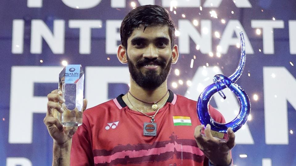 Kidambi Srikanth poses with his trophy after winning the men's singles final at the French Open Badminton tournament at the Coubertin Stadium in Paris.