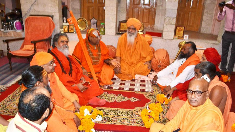 Akhil Bharatiya Akhada Parishad office-bearers try to bring about an agreement between two factions of Shri Panchayati Akhara Nirmala in Haridwar on Monday.