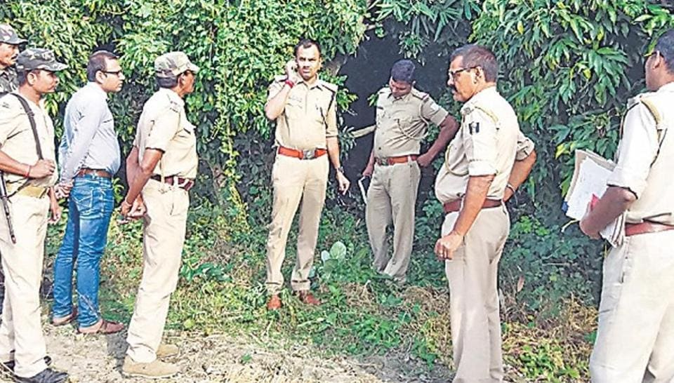 Policemen at the scene of the crime after two minor girls were killed and their bodies hung by a tree in Bihar's Muzaffarpur on Sunday.