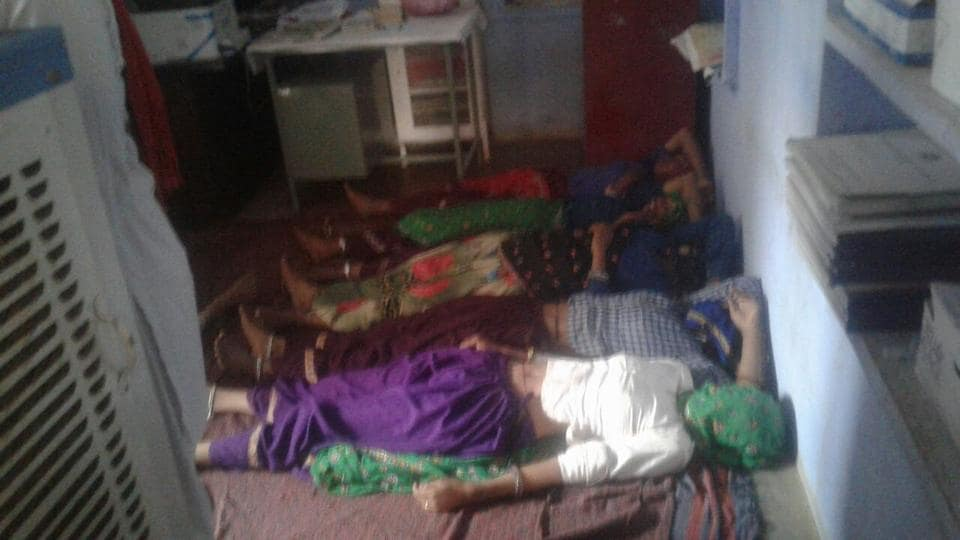 The women were laid down on blankets spread on the floor in the PHC's corridor.