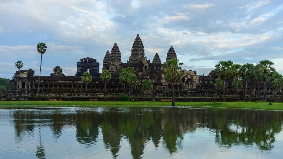Angkor Wat is a large Hindu temple built in the early 12th century and is admired for its grandeur, and the many exquisitely carved features that adorn its ancient walls.