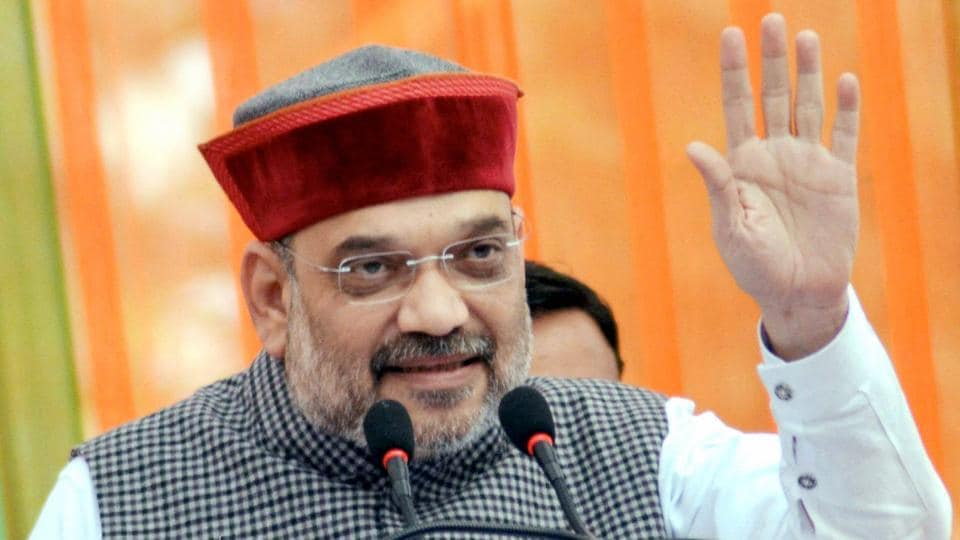 BJP chief Amit Shah addresses an election rally while campaigning for party candidate Arjun Singh from Jawali constituency in Kangra district on Monday.