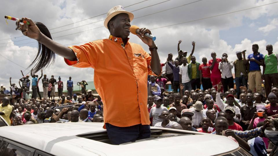 Opposition leader Raila Odinga greets supporters in the slum of Kawangware in Nairobi on October 29, 2017. Warning that Kenya is in 'grave danger', Odinga said in an interview with The Associated Press on Sunday that the country's repeat presidential election was a sham and that a second re-vote should be held within 90 days. Countering IEBC claims, Odinga said only 3.5 million had cast ballots. (PTI / AP)