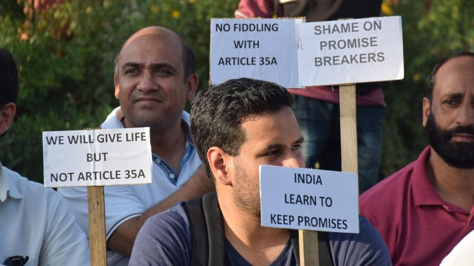 Civil society members of Kashmir protest in Srinagar against the proposed removal of Article 35A.