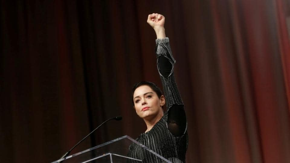 Actor Rose McGowan raises her fist after addressing the audience during the opening session of the three-day Women's Convention at Cobo Center in Detroit, Michigan, US.