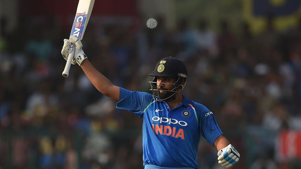 Indian cricketer Rohit Sharma raises his bat after hitting a century during the third ODI against New Zealand at Green Park in Kanpur on Sunday.