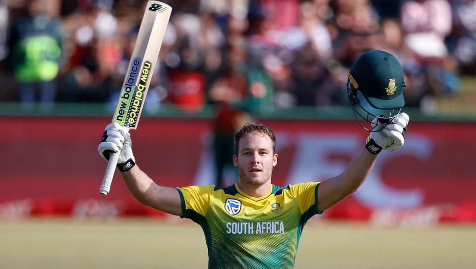 South African batsman David Miller raises his bat and helmet as he celebrates scoring the fastest T20I century.