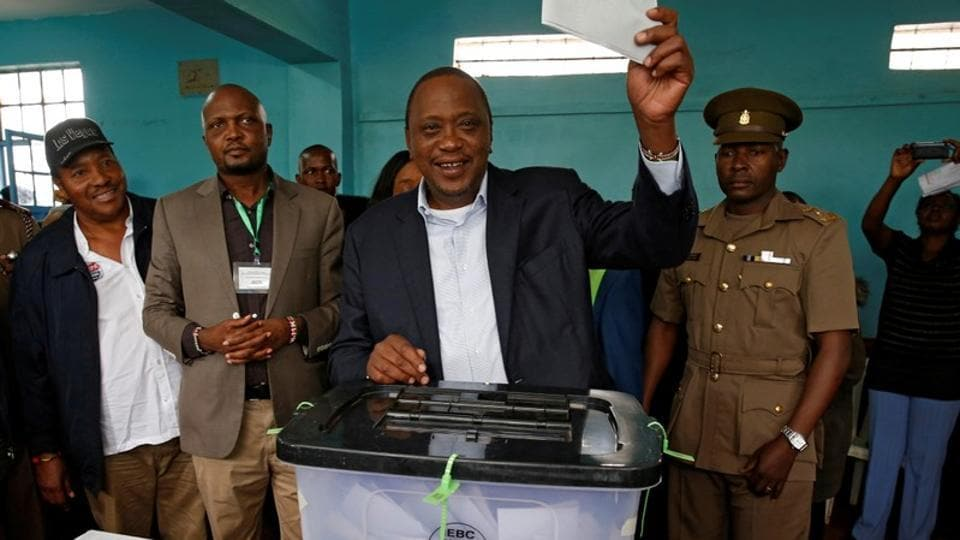 Kenya's President Uhuru Kenyatta casts his vote during the presidential election re-run in Gatundu, Kenya on October 26, 2017. While the Supreme Court overturn in the earlier vote was hailed as a chance to deepen democracy, acrimonious bickering between Odinga and Kenyatta --whose fathers were rivals before them-- has sharply divided a country where politics is already run along tribal lines. (Siegfried Modola / REUTERS)