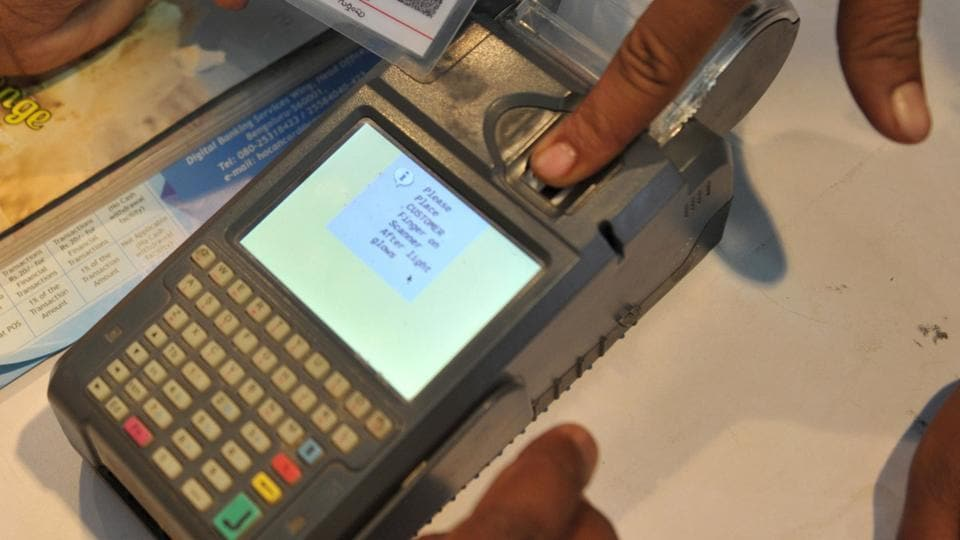 This file photo shows a person giving a thumb impression to withdraw money from his bank account with his Aadhaar or Unique Identification (UID) card.