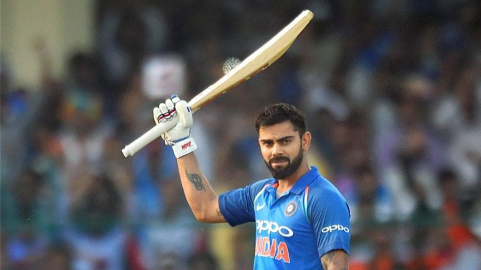 Virat Kohli celebrates his century during 3rd ODI cricket match against New Zealand at Green Park Stadium in Kanpur on Sunday. Virat Kohli today returned to the top of the ICC ODI rankings for batsmen after logging career-high rating points.