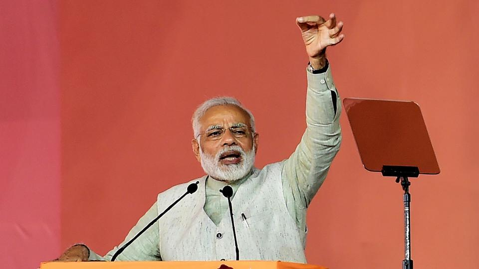 Prime Minister of India Narendra Modi addresses attendees at a congregation at the Palace Grounds in Bengaluru on October 29. Modi has accused the Congress of shamelessly lending its voice for Kashmir's azadi.