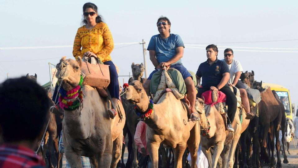Tourists enjoy a camel ride during the International Camel Fair in Rajasthan. The peak celebrations generally occur in the last five days with the festival ending on Kartik Poornima, the full moon day of Kartik in Hindu calendar.  (PTI)