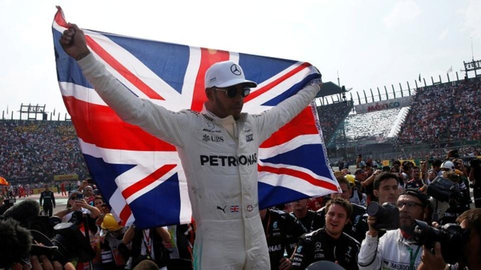 Lewis Hamilton won the 2017 Formula One world championship in dramatic style as he battled back from last while Max Verstappen secured victory in the Mexico Grand Prix.