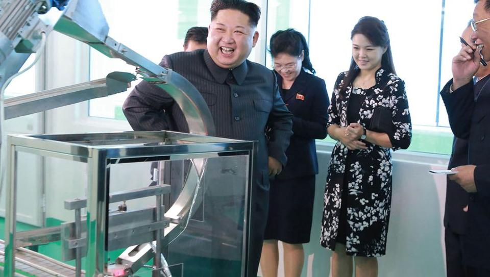 This undated picture released from North Korea's official Korean Central News Agency (KCNA) on October 29, 2017 shows North Korean leader Kim Jong-Un (L) inspecting the Pyongyang Cosmetics Factory, as his wife Ri Sol-Ju (2nd R) looks on.