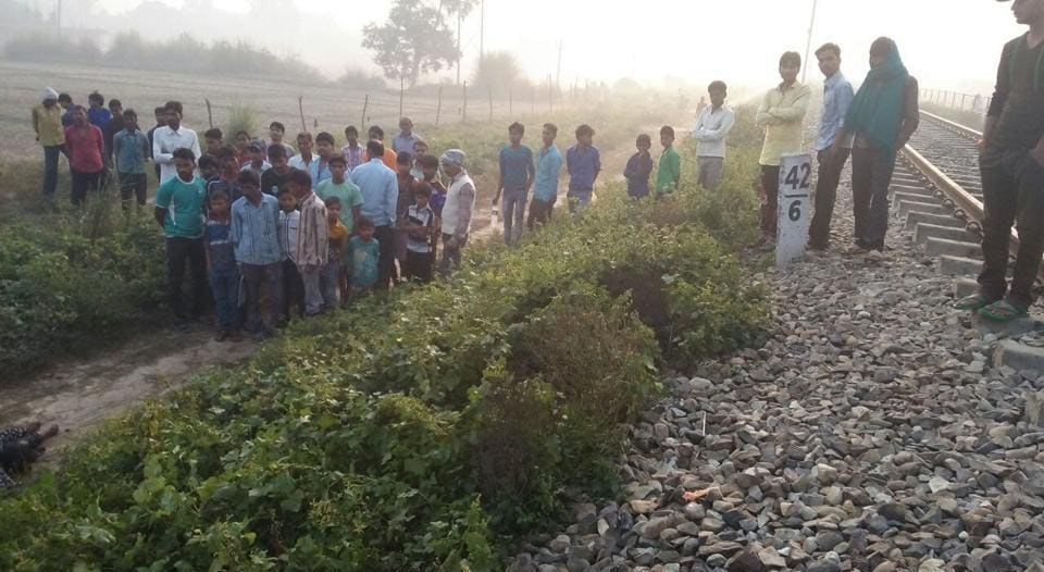 People gather near the railway track in Maigalganj where police found the body of a woman they first thought was Afreena Khatoon's.