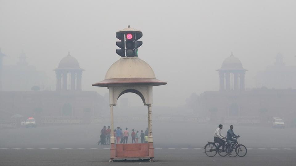 A cyclist peddles throught the morning smog in New Delhi.