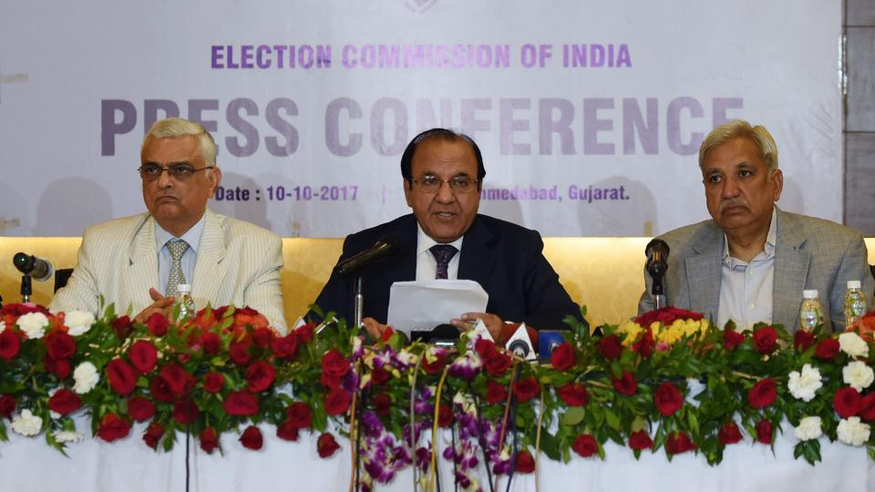 Chief Election Commissioner AK Joti (C) speaks next to Election Commissioners OP Rawat (L) and Sunil Arora (R) during a press conference at the Circuit House in Ahmedabad on October 10, 2017.