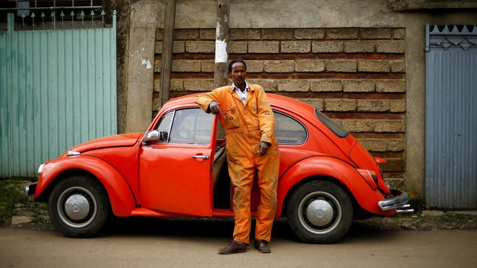 Ishetu Kinfe, 59, a mechanic, poses next to his 1965 Volkswagen Beetle at a garage in Addis Ababa, Ethiopia. Having driven the car for 19 years, he said, 'I can drive it anywhere because it is strong, easy to maintain and affordable'. At garages in Addis Ababa, cranky, 50-year-old Beetles enjoy a kind of life after death --their parts are never discarded but re-used to keep the city's remaining Beetles on the road. (Tiksa Negeri / REUTERS)