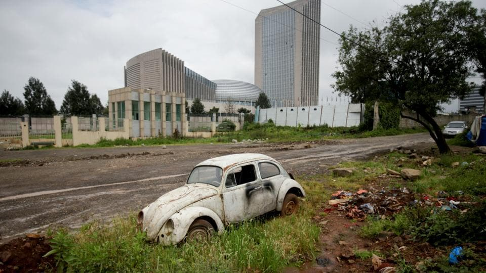 An abandoned Beetle car stands near the African Union headquarters in Addis Ababa. Production of the original version of these curvy little vehicles ended in 2003, and authentic spare parts can be hard to come by. Ethiopian mechanics have since resorted to 'slaughtering' some cars to keep others alive. (Tiksa Negeri / REUTERS)