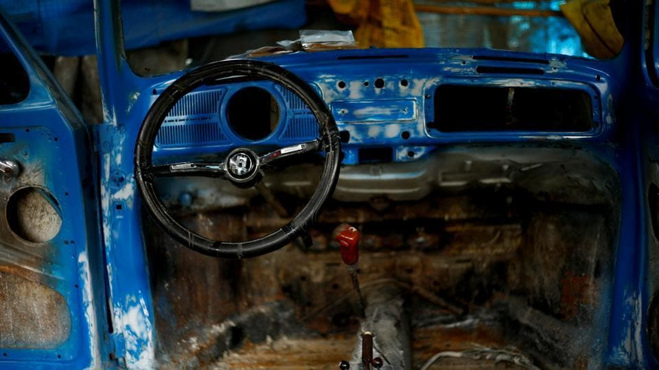 The interior of a stripped down Beetle car is seen at a garage in Addis Ababa. Kinfe considers the car an affordable and extremely reliable machine. 'They never fail you - they take you anywhere and have excellent functionality,' he said. 'I wish the Germans had continued producing them. They abandoned them and things started falling apart.' (Tiksa Negeri / REUTERS)