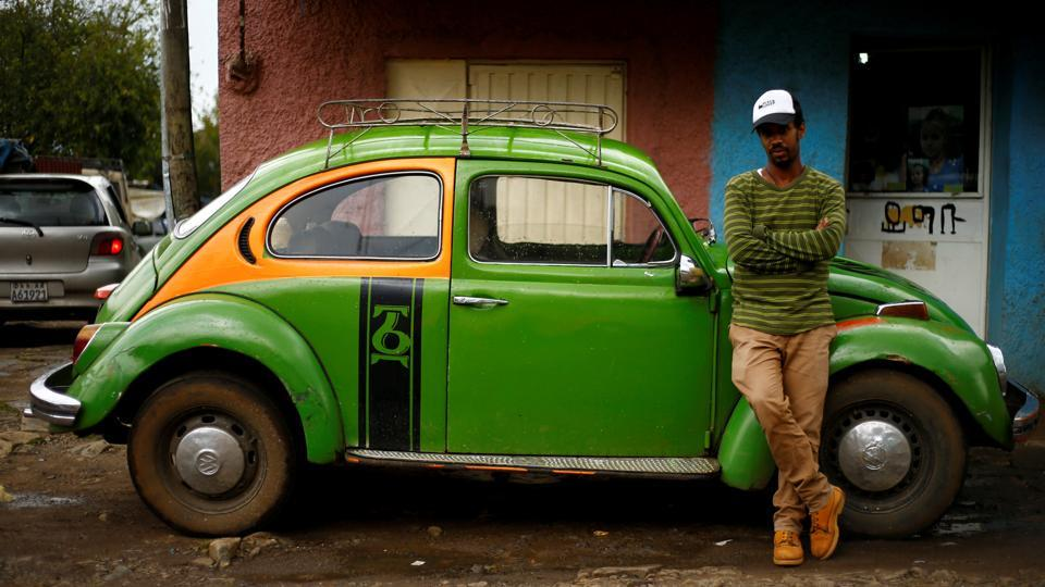 Minilik Shewaferaw, 30, poses next to his 1976 model Beetle in Addis Ababa. 'I chose Volkswagen because it is affordable, easy to park and my luxury car indeed', he said. About 8,000 vehicles are assembled in Ethiopia for the home market, about a quarter of them cars. Expensive imported models on the roads are also rising as a new middle class emerges but the pint-sized Beetle enjoys a loyal fanbase among the young who find it trendy. (Tiksa Negeri / REUTERS)