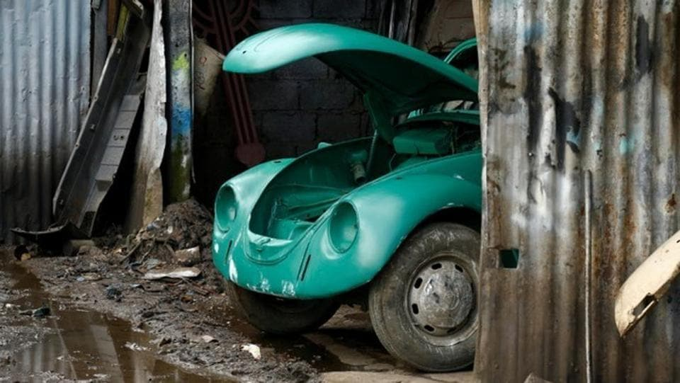 A VW Beetle is seen inside a painting room at a garage in Addis Ababa. 'They are lovely cars,' said Teferi Markos, a mechanic in Kinfe's garage. 'You get satisfied when you fix them. If you want to change the colour, they absorb any paint.' (Tiksa Negeri / REUTERS)