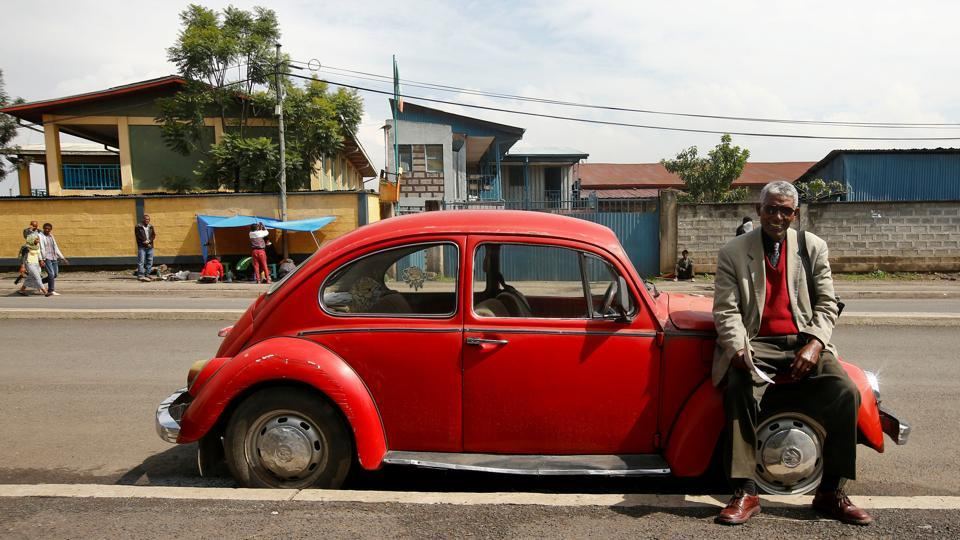 Siyum Haile, 72, a retired UN employee, poses next to his 1977 Beetle in Addis Ababa. He has used the car for 17 years because it's strong, consumes less fuel and most of all is the only car he can afford to buy in Ethiopia. While the young are drawn to the car for its throwback trendiness, the older generation is drawn by nostalgia to this iconic car. Either way, in Ethiopia the Beetle continues to live on! (Tiksa Negeri / REUTERS)