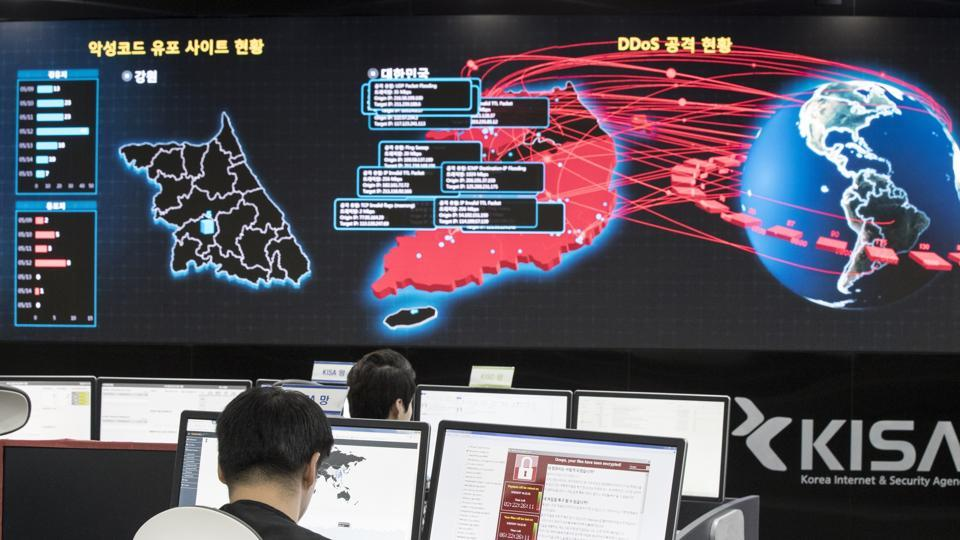 South Korea employees watch electronic boards to monitor possible ransomware cyberattacks at the Korea Internet and Security Agency in Seoul, South Korea, in May.