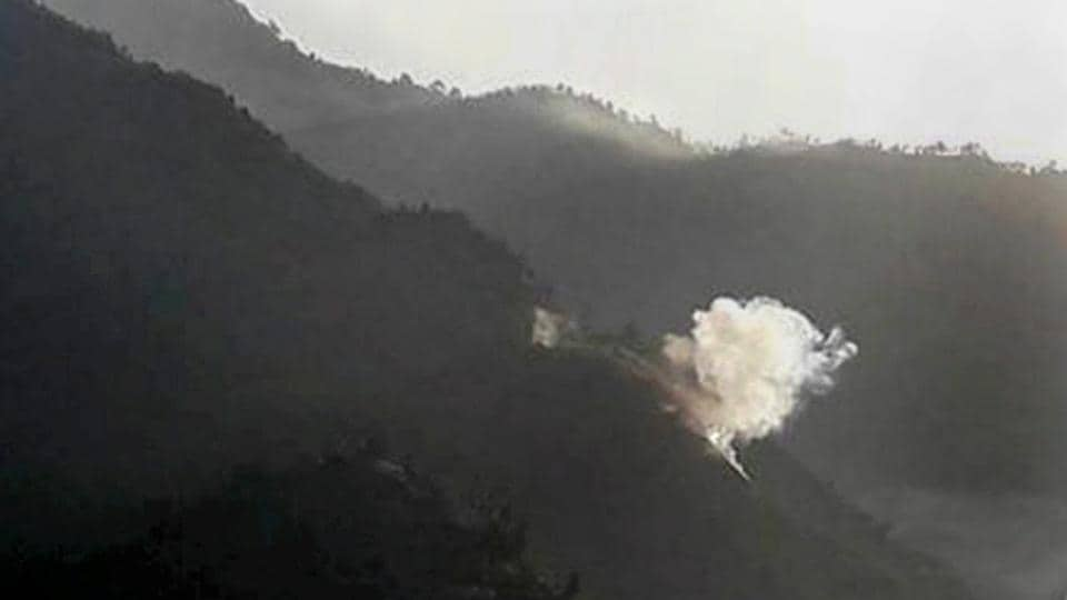 Smoke rises from a mortar fired by Pakistan near the Line of Control in Jammu and Kashmir's Poonch.