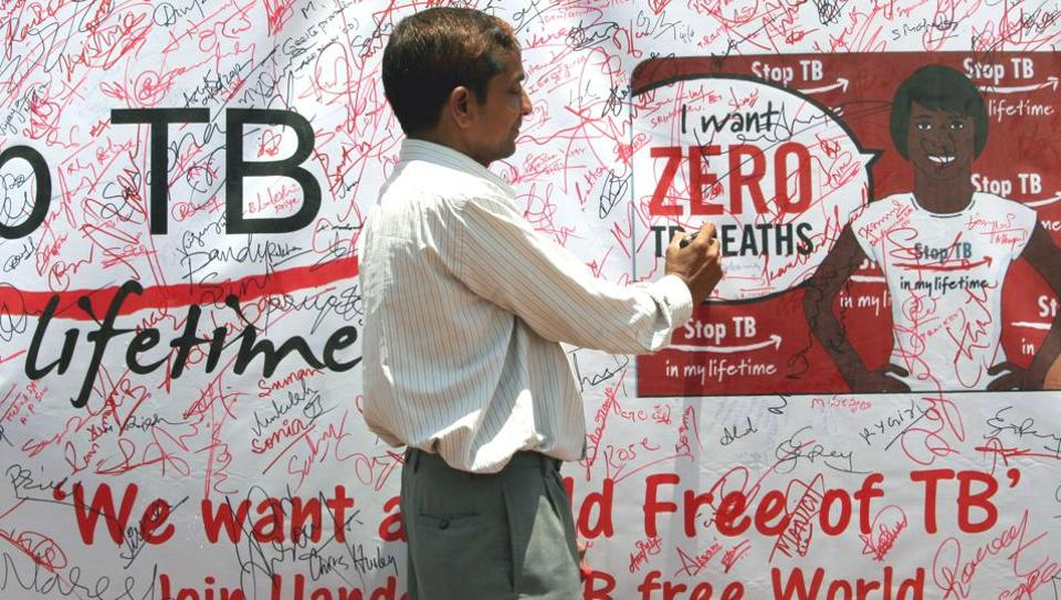 A man signs a signature campaign during a TB awareness programme in Hyderabad.