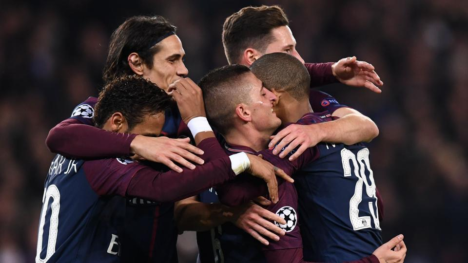 Paris Saint-Germain players celebrate after qualifying for the UEFA Champions League knockouts. They thrashed Anderlecht 5-0 at the Parc des Princes Stadium in Paris on Tuesday. (AFP)