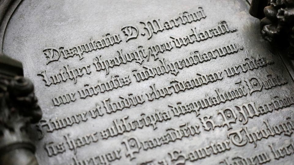 Martin Luther's theses engraved on the door of the Castle Church is pictured during the 500th anniversary of the Reformation in Wittenberg, Germany. The Reformation caused major upheaval in Europe, leading to wars, persecutions and exoduses, including the departure of the pilgrims for what was later to become America. (Hannibal Hanschke / REUTERS)