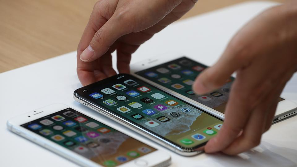 The new iPhone 8, iPhone X and iPhone 8S are displayed during an Apple special event at the Steve Jobs Theatre on the Apple Park campus on September 12, 2017 in Cupertino, California.