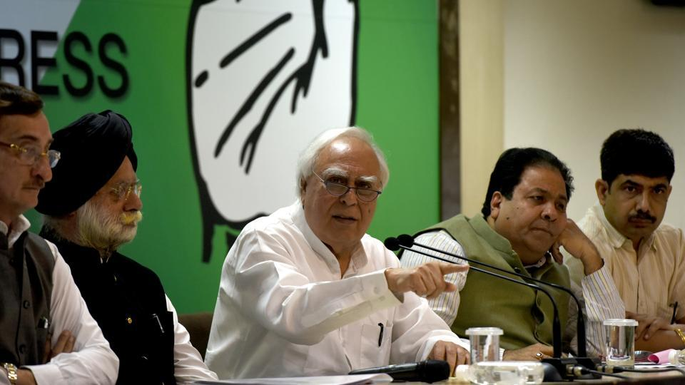 Congress leader Kapil Sibal and other leaders address the medi in New Delhi on Wednesday.