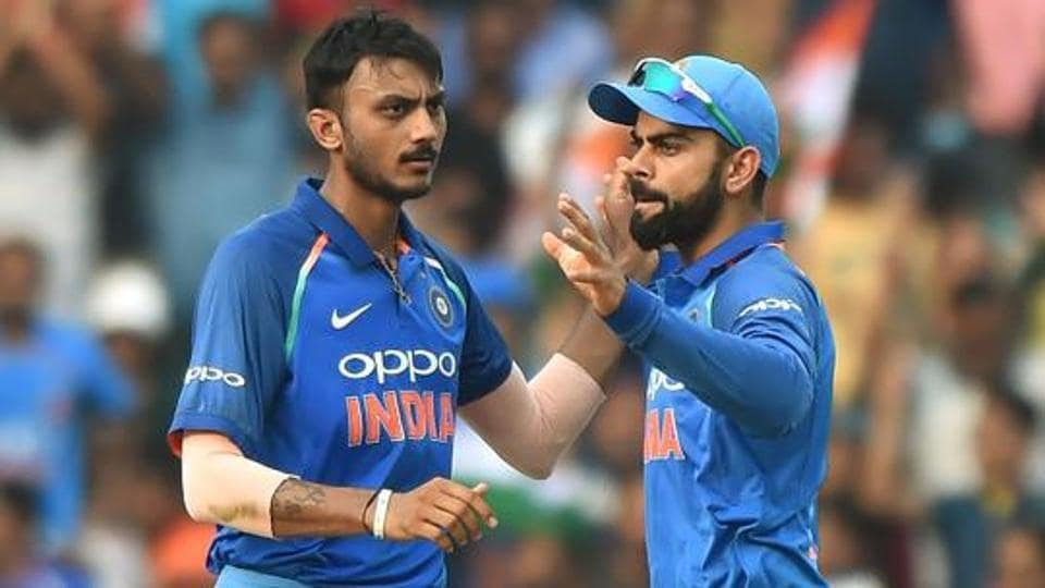 Axar Patel (L) finished with figures of 2/20 in India's 53-run win over New Zealand in the 1st T20I at the Feroz Shah Kotla on Wednesday.