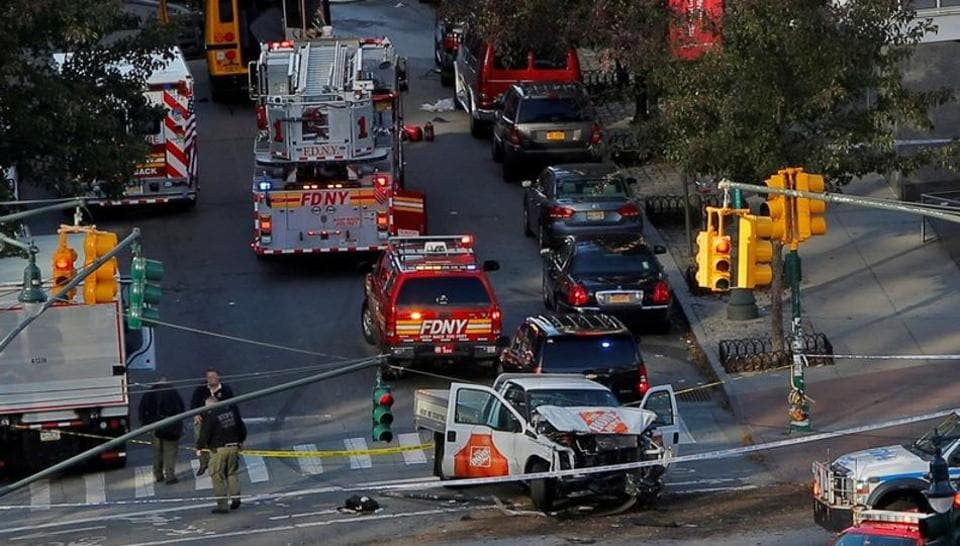 Emergency crews attend the scene of an alleged terror incident on West Street in Manhattan, New York on October 31 2017. A man in a rented pickup truck mowed down pedestrians and cyclists along a busy bike path near the World Trade Center memorial on Tuesday, killing at least eight and seriously injuring 11 in what the mayor Bill de Blasio called 'a particularly cowardly act of terror.' (Andrew Kelly / REUTERS)